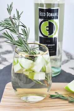 Our White Winter Sangria will make you forget all about the cold!  #EccoDomani #PintoGrigio #Sangria #WineCocktails 1 bottle of Ecco Domani Pinot Grigio, 1/2 cup club soda, 1/2 cup apple vodka, 2 apples sliced then chopped. Combine all ingredients except club soda in a pitcher and refrigerate for a min of 2 hours and a max of 8 hours.  Top with club soda when ready to drink and pour into wine glasses. Serves 6.