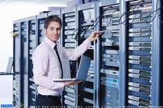 Technician servicing web hosting servers.