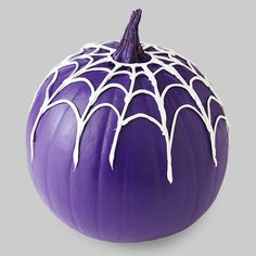 Mix things up this year with a purple pumpkin. Drape it with a caulk spiderweb you can make in minutes using the pattern provided with the instructions.