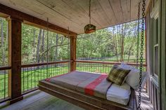 This porch's full-size bed swing is perfect for lazing away the afternoon with a good book and a glass of iced tea.