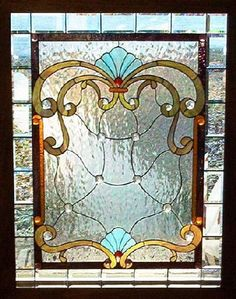 My mother used to work with stained glass. A vintage piece hung in a window can just make the whole room.
