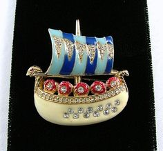 This is such a wonderful creation by CINER! Viking sailing ship brooch in bright enamels and crusted with shiny rhinestones! Ship is a creamy white