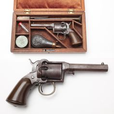 Remington-Beals First Model Pocket Revolver - Chambered in .31 percussion caliber, this small five-shot handgun was made only from 1857-1858 and was lot (or batch) numbered.  This example is just a bit finer than most production guns, as it came with a nice wooden case that holds significant accoutrements, including a bullet mold and loading tools.