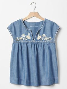 Image result for pictire of J. Crew light blue chambray embroidered top with short puffy sleeves and cream embroidery