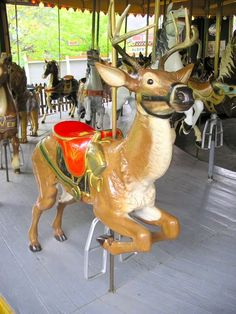 """the deer and a rearing horse at The """"Antique Carousel"""" at the Centreville Amusement Park.  Centre Island, Toronto, Canada."""