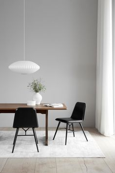 Spine Chairs designed by Space Copenhagen. Leather: Premium 88 black. Wood: Oak black lacquered. C18 Table designed by Børge Mogensen. Wood: Smoked Oak