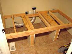 laundry platform... We will be making this sometime within the month =0} Link for the How-to: http://contractorkurt.com/2012/01/04/raised-laundry-platform/