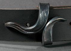 Simple elegant forged belt buckle.