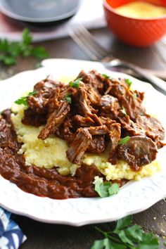 Pull out a big pan and get ready for a delicious dish that's perfect for cooler weather. Red Wine Braised Short Ribs with Polenta is easy to make – it just takes a bit of cooking time. Start early and enjoy later.