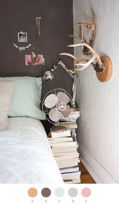 neutral walls, stacks of books, simple but cozy bedroom inspiration