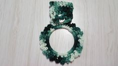 Towel Holder Crocheted Ring Variegated Shades of Green Crochet Rings, Towel Holder, Cloth Napkins, Shades Of Green, All Things, Christmas Gifts, How To Make, Handmade, Stuff To Buy