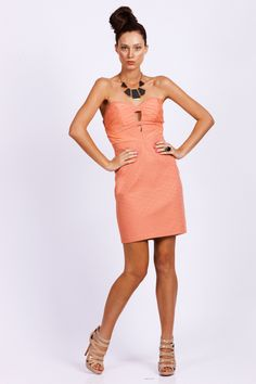 SEDUCE Coral Strapless Dress. Textured strapless fitted mini dress with cutout detail at the bust. Available in white or tropic (peach/pink). Features a ruched bust and concealed side zip. Perfect Party Dress.