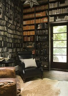 My dream house will have a library. Love the old fashioned look of this one. No books arranged by color here!
