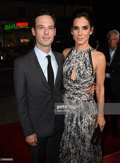 Scoot McNairy and Sandra Bullock attend the premiere of Warner Bros. Pictures' OUR BRAND IS CRISIS at TCL Chinese Theatre on October 26, 2015 in Hollywood, California.