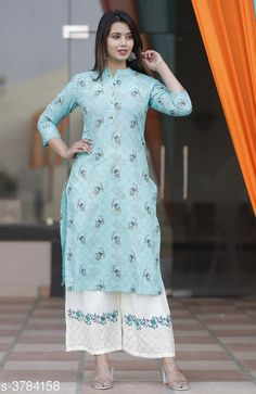 Kurta Sets Women Rayon A-line Printed Long Kurti With Palazzos Fabric: Kurti - Rayon Palazzo - Rayon Sleeves: Sleeves Are Included Size: Kurti - S - 36 in M - 38 in L - 40 in XL - 42 in XXL - 44 in Palazzo - S - 28 in M - 30 in L - 32 in XL - 34 in XXL - 36 in Length: Kurti - Up To 48 in Palazzo - Up To 40 in Type: Stitched Description: It Has 1 Piece Of Women's Kurti With 1 Piece Of Palazzo  Color: Rama Green Work: Kurti - Printed Palazzo - Embroidered Country of Origin: India Sizes Available: S, M, L, XL, XXL, XXXL   Catalog Rating: ★3.9 (437)  Catalog Name: Women Rayon A-line Printed Long Kurti With Palazzos CatalogID_530221 C74-SC1003 Code: 655-3784158-0441