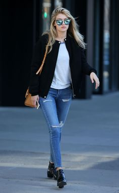 Good Jeans from Celebrity Street Style Oh, Gigi Hadid, can you do no wrong? The budding supermodel kills the street style game with a cool black jacket and A GOLD E jeans combo paired with a peanut Michael Kors satchel.