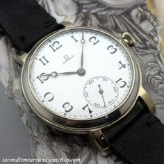 """A 1931 Vintage Omega Pocket Watch to Wristwatch Conversion with a white, enamel dial with black, decorative Arabic numerals, blued-steel, Breguet """"Moon"""" hands, and a 15-jewel, manual caliber 40.65.T2.15-P movement. A beautifully, one-of-a-kind watch! (Store Inventory # 10469, listed at $2350, available for purchase online and in store.) #omega #pocket #watch #conversion #to #wristwatch #simple #time #only #white #enamel #dial #vintage #watch #classic #watches #timepiece #stawc"""