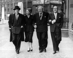 NOVEMBER 16: Actors Charles BOYER, Agnes MOOREHEAD, Charles LAUGHTON and Sir Cedric HARDWICKE strolling through a street of Manchester together on June 18, 1951