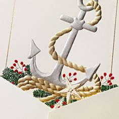 Let's set sail on a sleigh that prefers dolphins to Dasher and Dancer. Season's greetings from the seaside, courtesy of an engraved anchor surrounded by all the nautical trimmings.