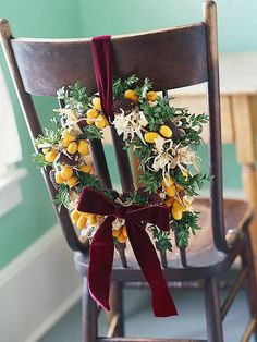 chairs are another great place to display seasonal wreaths