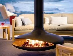 The Gyrofocus fireplace is enjoyed all around the globe. Checkout the Southern Ocean Lodge, displaying this fireplace among its luxurious ocean views. Suspended Fireplace, Hanging Fireplace, Floating Fireplace, Cosy Fireplace, Outdoor Spaces, Outdoor Living, Outdoor Decor, Outdoor Patios, Outdoor Kitchens