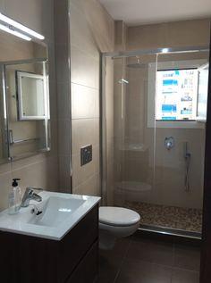 baño reformado por AC reformas con muebles, grifería y sanitarios de nuestra tienda