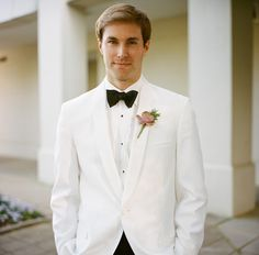 Groom in White Tux   photography by http://www.abryanphoto.com