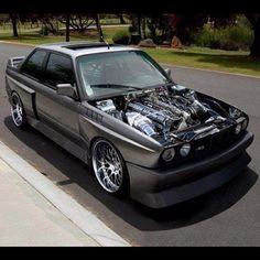 A ridiculously modified E30 3-series BMW.