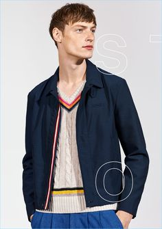 A smart vision, Roberto Sipos sports a jacket, sweater vest, and pleated trousers from Zara Man's Studio collection.