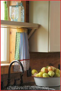 Home Tour of Log Cabin - colorful curtains and an enamelware bowl overflowing with fruit provide a down-home feel