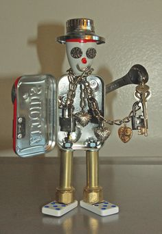 "Reserved: ""Removing Chains, Unlocking and Opening Hearts""- found object art, upcycle, junkbot"