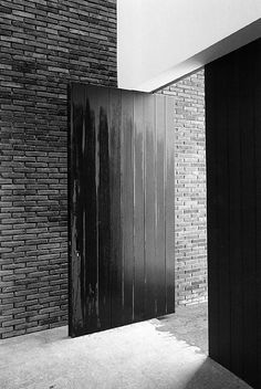 Entry hall of the VDD house by Vincent van Duysen. Nice material palette of brick, wood and plaster.