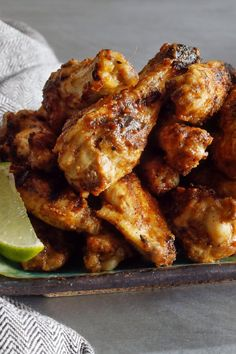 Here& a lively twist on the traditional chicken wing Just grill or broil the wings until they& cooked through, then toss with a simple sauce of coconut milk, peanut butter, soy sauce, fish sauce and lime juice Return to the grill or oven until they& crisp Roasted Chicken Wings, Cooking Chicken Wings, Chicken Wing Recipes, Smoked Chicken, Butter Chicken, Thai Peanut Chicken, Chicken Satay, Barbecue Chicken, Cookout Appetizers
