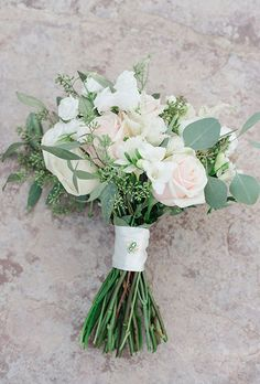 Brides: Classic Rose and Hydrangea Bouquet. A mixed bouquet of blush, coral, and yellow roses, ranunculus, hydrangea, and eucalyptus leaves, created by Carolyn's Flowers.