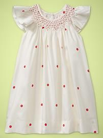 You can't avoid pink altogether, right? Polka dot smocked dress.