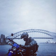 Simon navigating his way through a rainy Sydney city with nothing but a map and compass! We love the juxtaposition of the Sydney Harbour Bridge behind a trail bike and rider in full adventure mode.. | : @sjmho  #Sydney #sydneyharbour #sydneyharbourbridge #xt250 #yamaha ridetheworld #dualsportlife #advrider #motorcycletrip #twowheeltravellers #ridingadventure #dualsport #adventure #riding #australia #seeaustralia #exploreaustralia #exploreoz #astoryworthliving #adventureriding…