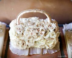 Fresh-flower-girl-hand-bag-purse.  This would be a beautiful table centerpiece.