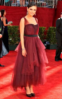 Mila Kunis rocks the red carpet with a Monique Lhuillier dress and Ferragamo shoes at the 2009 Emmy Awards