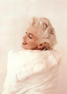 Marilyn. White fur sitting. Photo by Milton Greene, 1955.