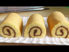 A good Swiss roll is very stretchy. It can stretch and bend into a roll without cracking. The flexibility is due to how the eggs are whisked. If your cake is stiff, it'll crack no matter how you roll it. Vanilla Swiss Roll Recipe, Sweet Recipes, Cake Recipes, Asian Recipes, Jelly Roll Cake, Swiss Roll Cakes, Chocolate Swiss Roll, Cake Ingredients, Rolls Recipe