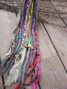 Gypsy Marsala Wool Dread, Dreadlock extensions.  Hand dyed and wrapped in recycled sari yarn and sari ribbon, with bells and wood beads.
