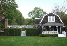 Modest vintage shingle style house with gambrel design of roof facing the front.  Also, garden larger than house.  All a potential/probable 'tear-down'?