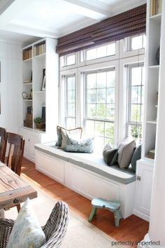 living/dining: window seat with higher units either side, doesn't need to be full height... look for ikea hack