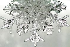 Incredible snowflake photo, a magical natural ice crystal that is the heart of winter. By Liz West