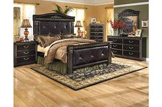 """The Coal Creek Mansion Bedroom Set from Ashley Furniture HomeStore (AFHS.com). The grand scale and rich traditional beauty of the """"Coal Creek"""" bedroom collection creates an elegant bedroom that is sure to have you sleeping in sophisticated style."""