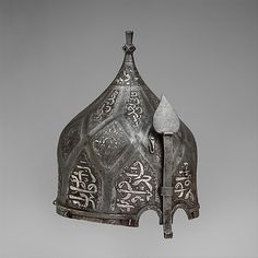 Turban Helmet  late 15th century Helmets of this type are usually called turban helmets because of their large bulbous shape and the flutings that imitate the folds of a turban. Because certain dervish groups wore turbans wound with a prescribed number of folds to represent an important mystical number, it is likely that turban helmets were regarded not merely as armor but also a kind of religious insignia, their very shape marking the wearer as a fighter in the Holy War. Turban helmets....