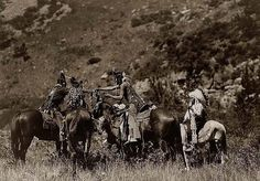 You are viewing an impressive image of of Indians Trading. It was taken in 1905 by Edward S. Curtis. The picture shows Crow men on horseback apparently involved in an exchange of Goods. One of the Indians is wearing a War Bonnet We have created this collection of pictures primarily to serve as an easy to access educational tool. Contact curator@old-picture.com. Image ID# 733EB873