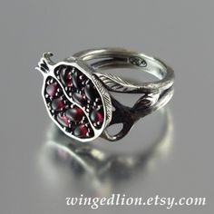 Pomegranate ring. This would be GREAT for a Nico DiAngelo cosplay (genderbent, of course). >>> or Bianca
