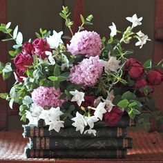 Filled with mixed scented red spray roses with pink hyacinths and paperwhite narcissi accompanied with aromatic seasonal foliage and herbs.