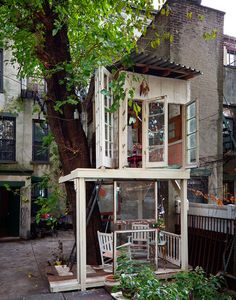 Brooklyn tree house, made of found or reclaimed materials